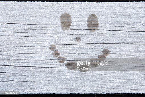 Smile face on the frozen wooden boards. Background. : Foto de stock