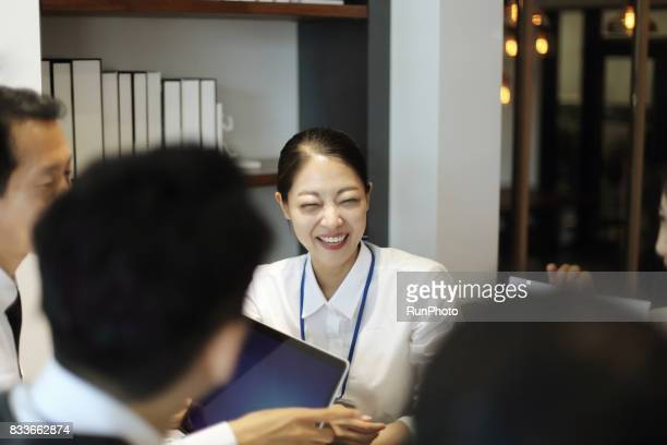 Smile female employee in the company Business image
