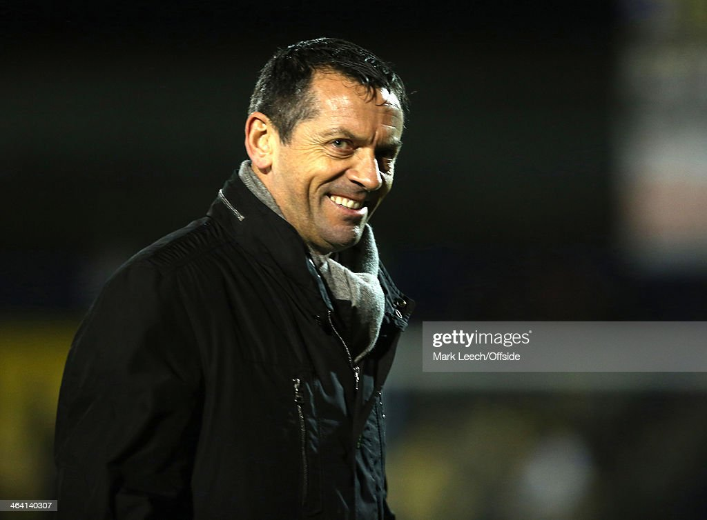 A smile from winning Southend manager Phil Brown during the FA Cup Third Round match between Southend and Millwall at Roots Hall on January 4, 2014 in Southend, England.