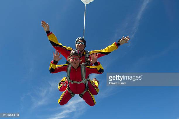 A smile girl in free fall as skydive passenger.