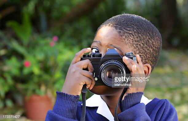 Smile - Schoolboy with a Camera