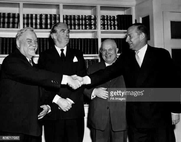 Smiles for four as Marshal Nikolai Bulganin the Soviet Premier reaches across to shake hands with Mr Selwyn Lloyd the British Foreign Secretary at...