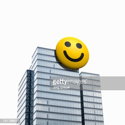 Smiley button on a highrise building : Stock Photo