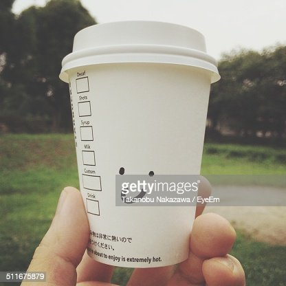 Smiley drawn on disposable coffee cup