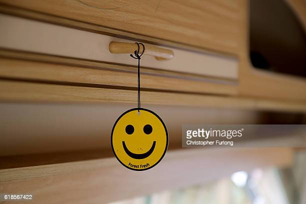 A smiley face air freshener is left inside a caravan in the now nearly deserted 'Jungle' migrant camp on October 27 2016 in Calais France The French...