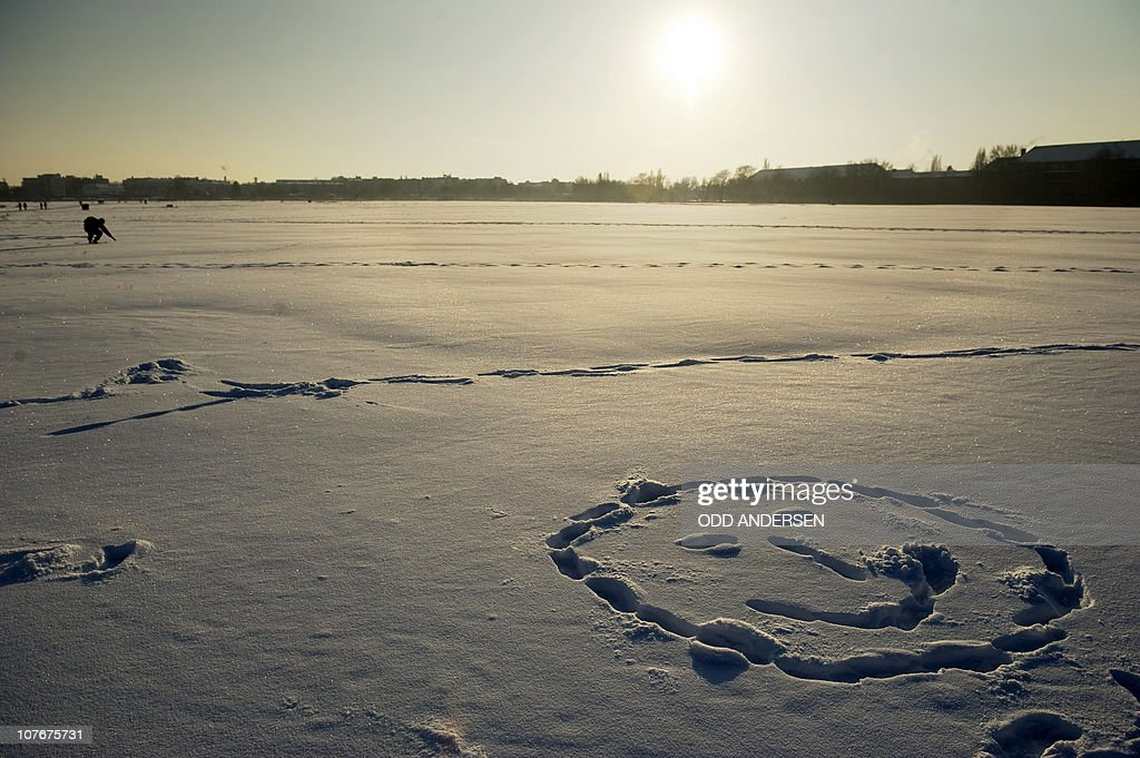 A smiley face is made in the snow as people enjoy the cold but sunny weather using the old inner city airport Tempelhof as a ski track and walking ground in Berlin, December 18, 2010.