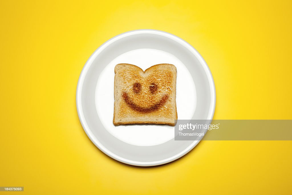 Concept photograph of a toasted toast on a plate and yellow background.