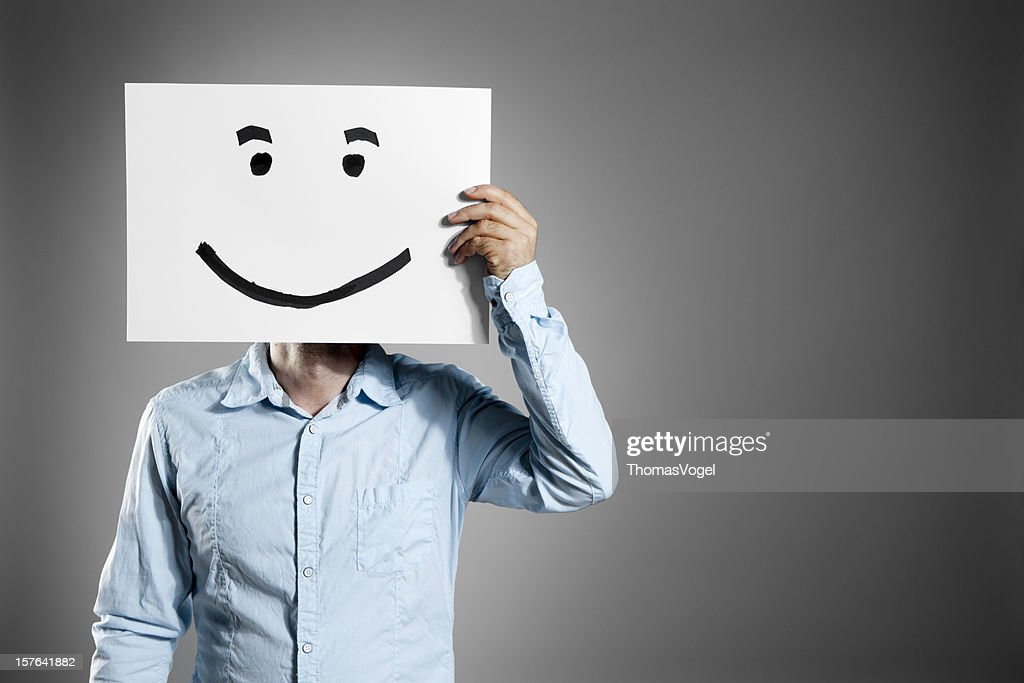 Technology Management Image: Smiley Man Business Mask Face Smiling Holding Hand Paper