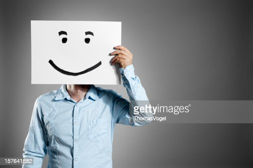 Smiley man. Business Mask Face Smiling Holding Hand Paper