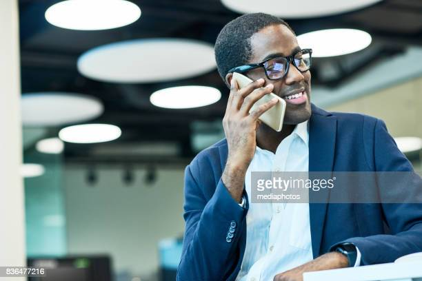 Smiling account manager talking to client