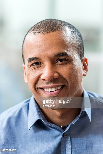 Smiling African American businessman looking at camera.