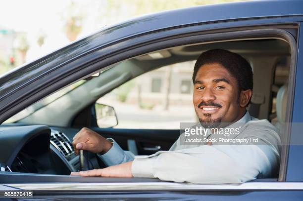 Smiling African American man driving car