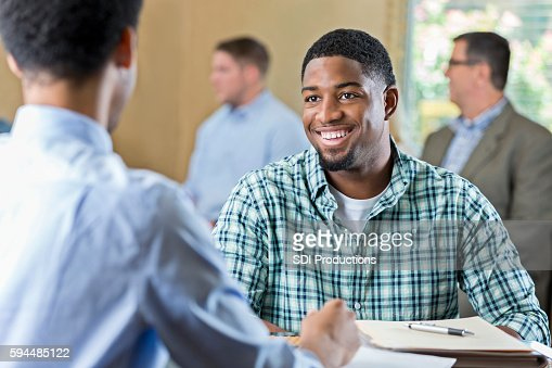 Smiling African American young adult at a job interview