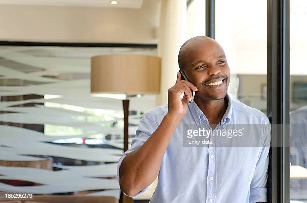 Smiling African businessman on the phone