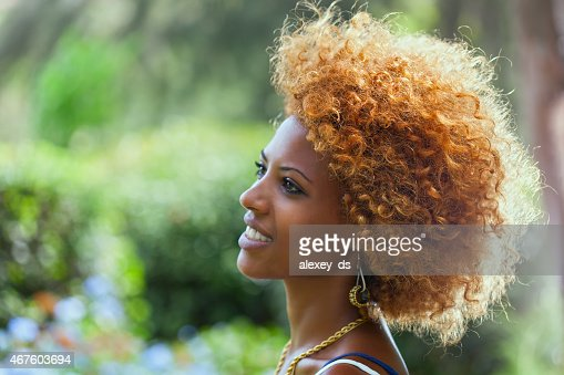 Smiling African woman. Outdoors profile portrait