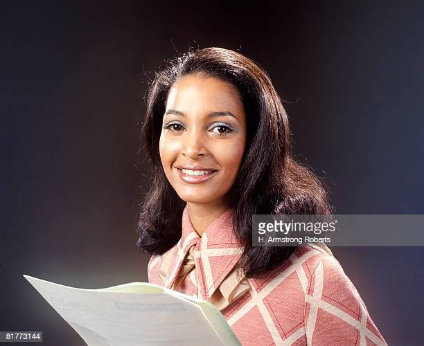 Smiling African-American Woman Reading From Papers Script Spokesperson Reporter Portrait.