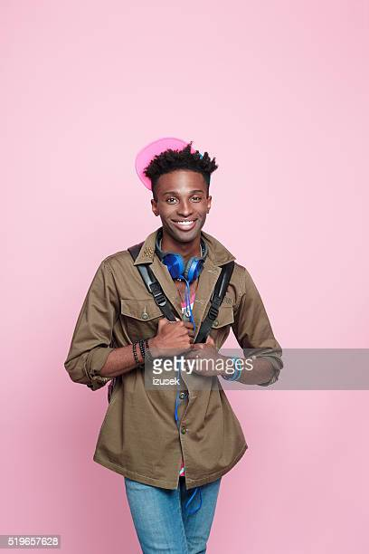 Smiling afro american guy, Studio portrait, pink background