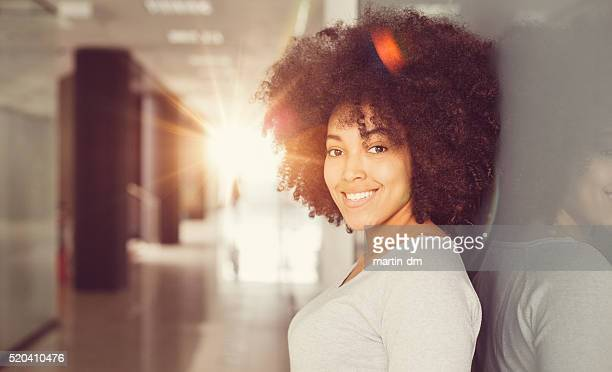 Smiling afro-american woman looking at camera