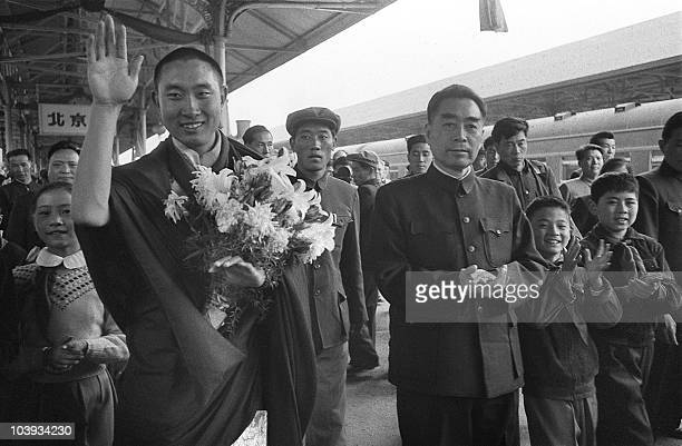 Smiling and waving Panchen Lama a spiritual leader and teacher in Tibetan Buddhism is welcomed 20 April 1959 at Beijing railway station by Chinese...