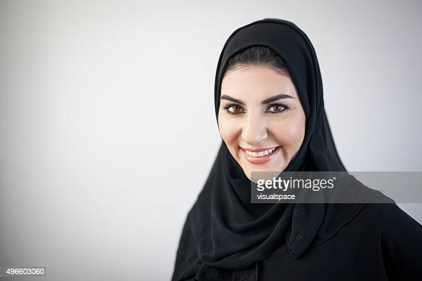Smiling Arab Woman with Light Grey Vignetted Background
