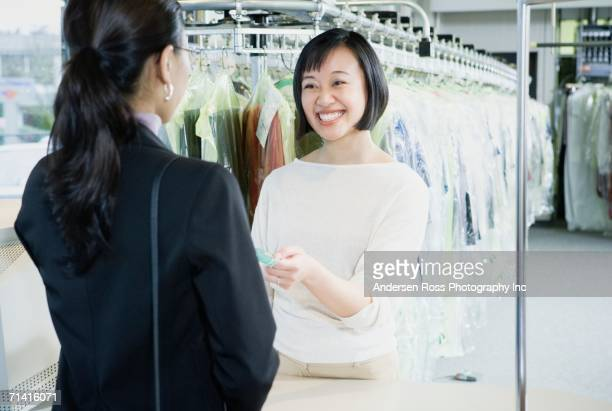 Smiling Asian drycleaner
