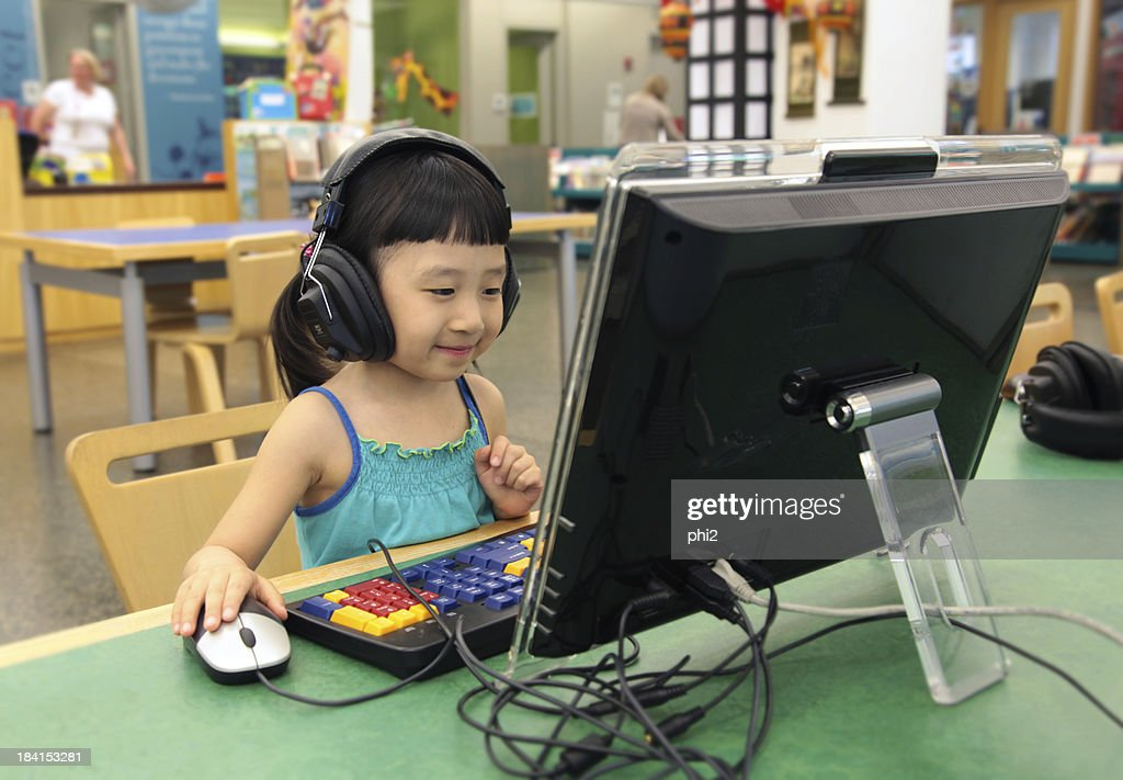 Asian Girl's Using Computer in A Library