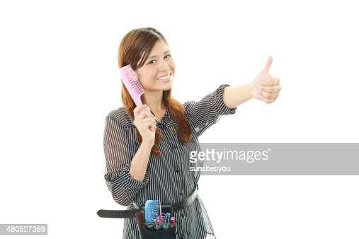 Smiling Asian hairdresser : Stockfoto