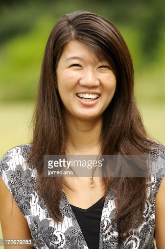 smiling asian headshot