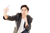 Asian man holding a smart phone