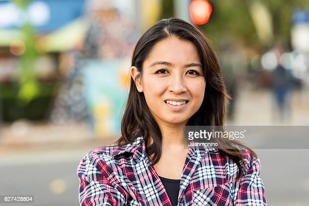 Smiling asian woman looking at the camera