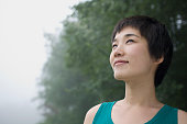 Smiling Asian woman outdoors