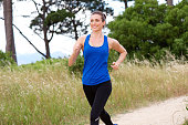 Portrait of smiling attractive woman speed walking