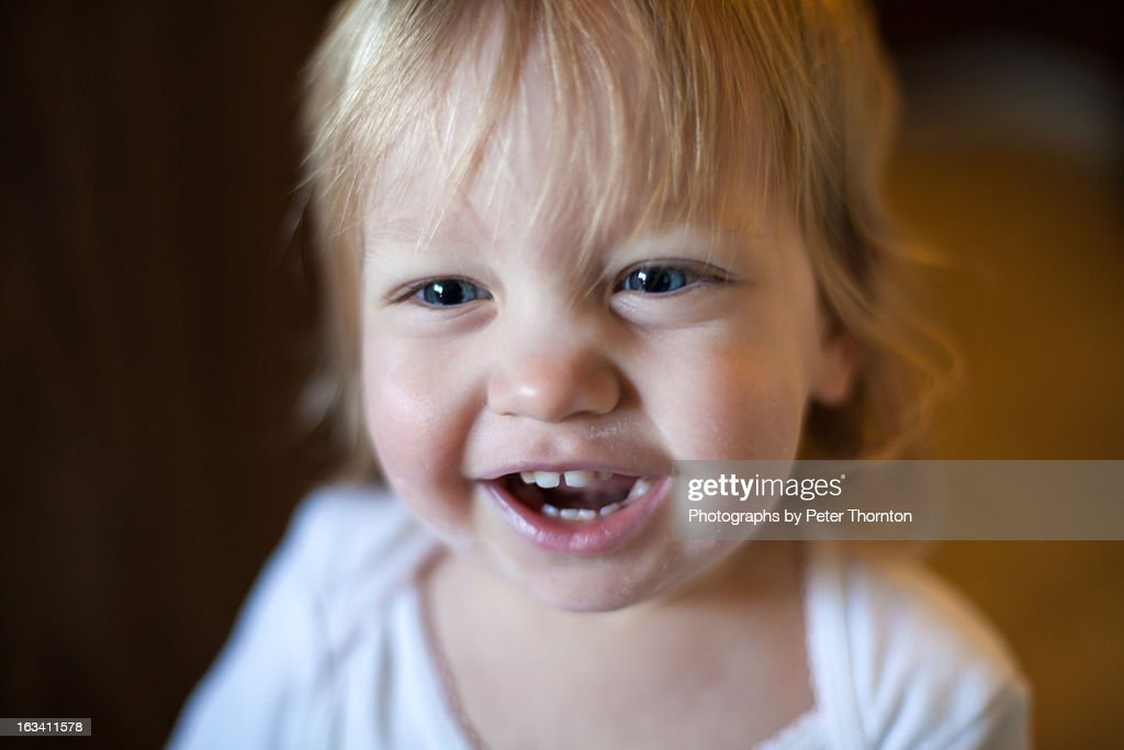 Smiling baby girl : Stock Photo