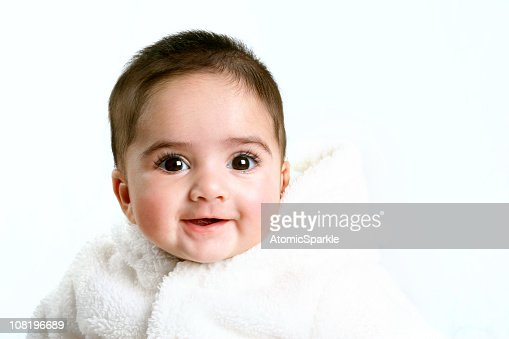 Smiling Baby Girl Wearing Fluffy White Coat : Stock Photo