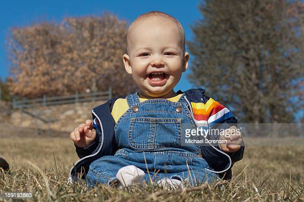 Smiling Baby in Overalls