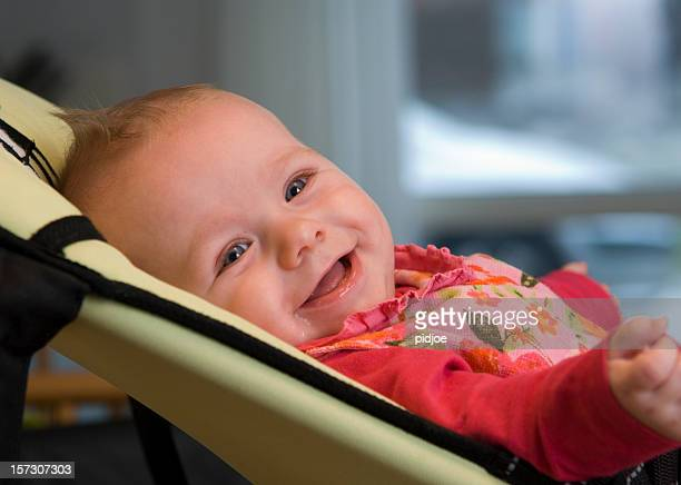 smiling baby in rocking chair
