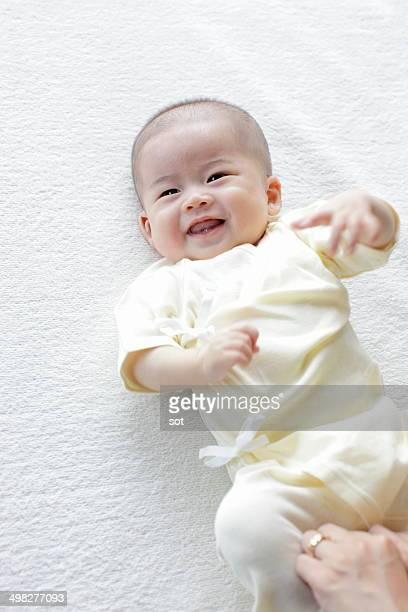 Smiling baby lying on blanket