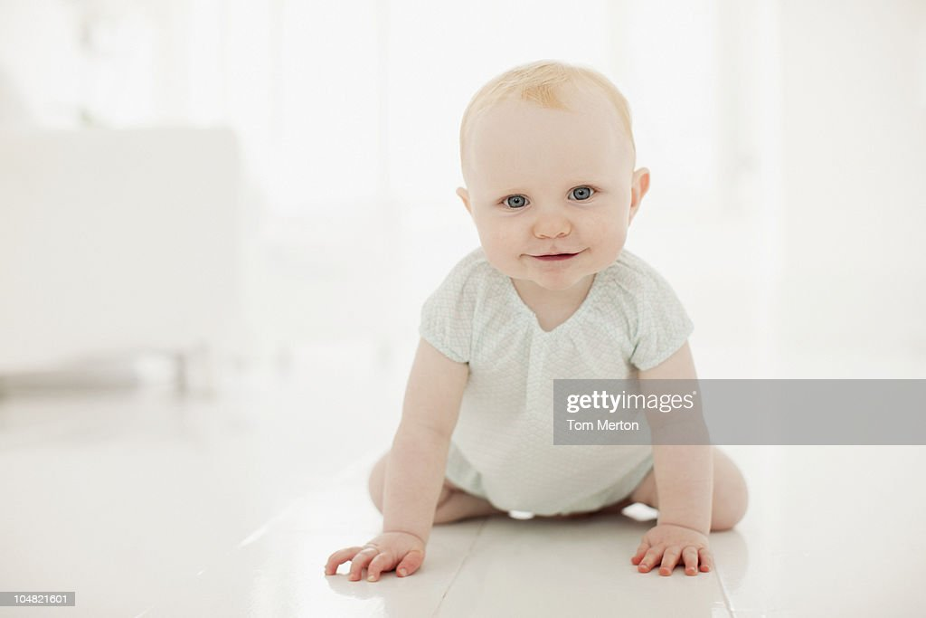 Smiling baby on floor : Stock Photo