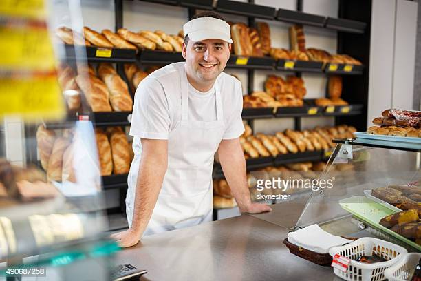 Smiling baker looking at camera in bakery.