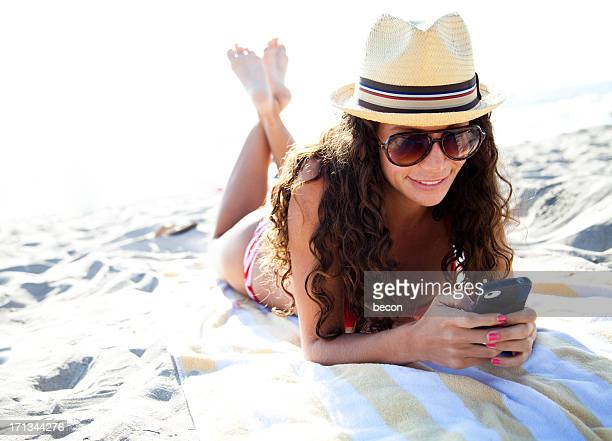 Smiling Beach Woman on Mobile Phone
