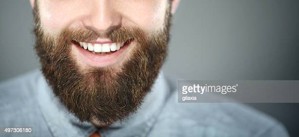 Smiling bearded man.