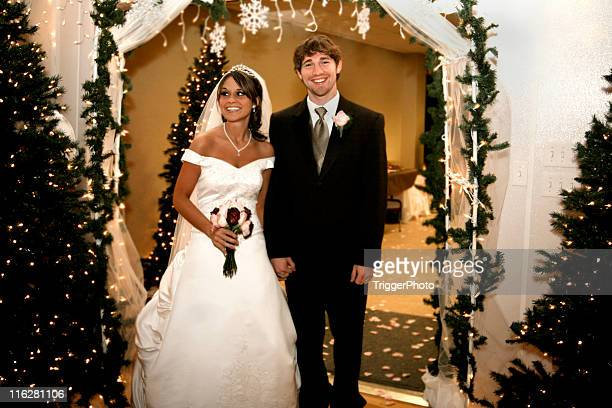 Smiling beautiful newly married couple walking out of church