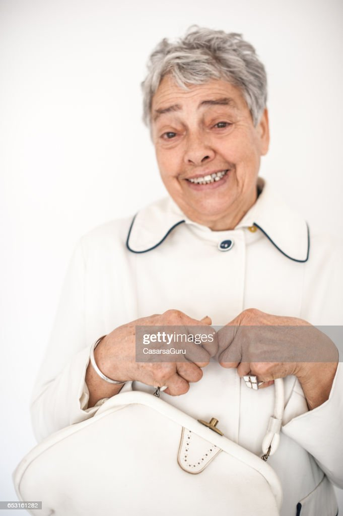 Smiling Beautiful Senior Woman In White Outfit : Stock-Foto