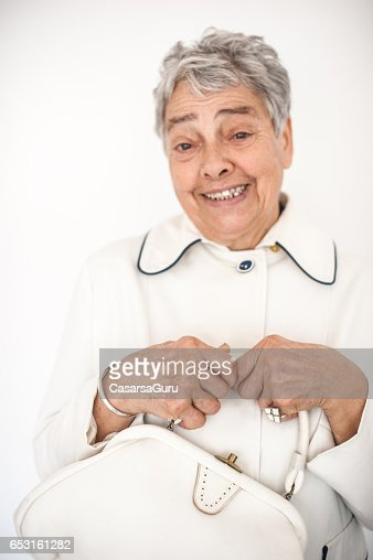 Smiling Beautiful Senior Woman In White Outfit : Bildbanksbilder