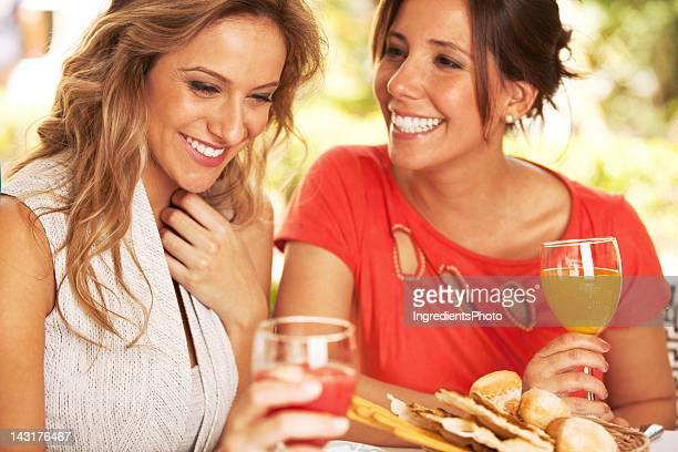 Smiling beautiful women having a good time in the restaurant.