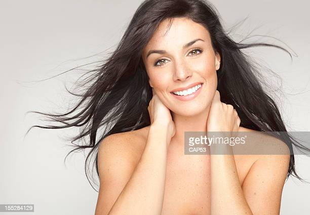 Smiling Beautiful Young Woman Portrait With Hair Blowing