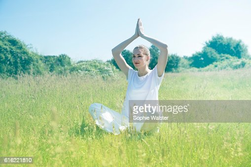 smiling beautiful young yoga woman praying for toned spiritual mindfulness : Stock-Foto
