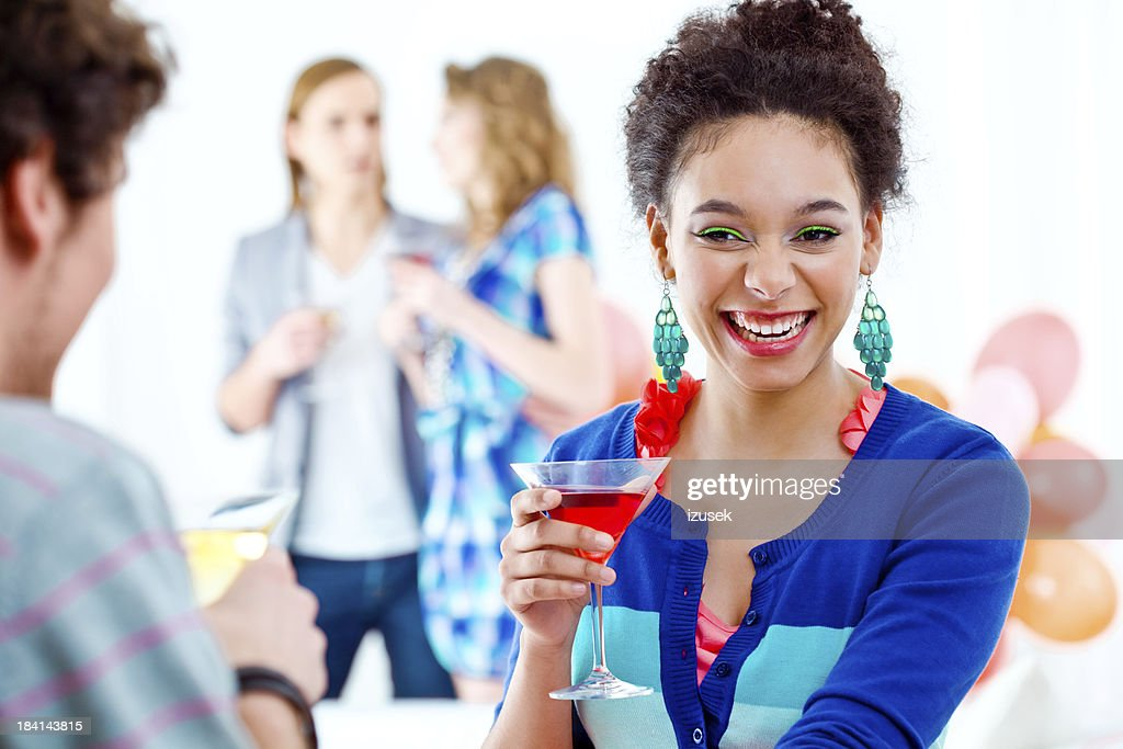 Smiling beautifull woman at a party : Stock Photo