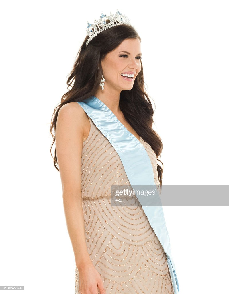 Smiling beauty queen looking away : Stock Photo