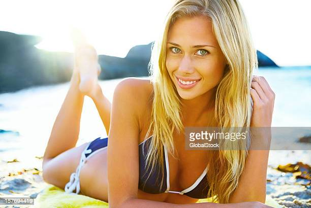 Smiling bikini woman lying on the beach